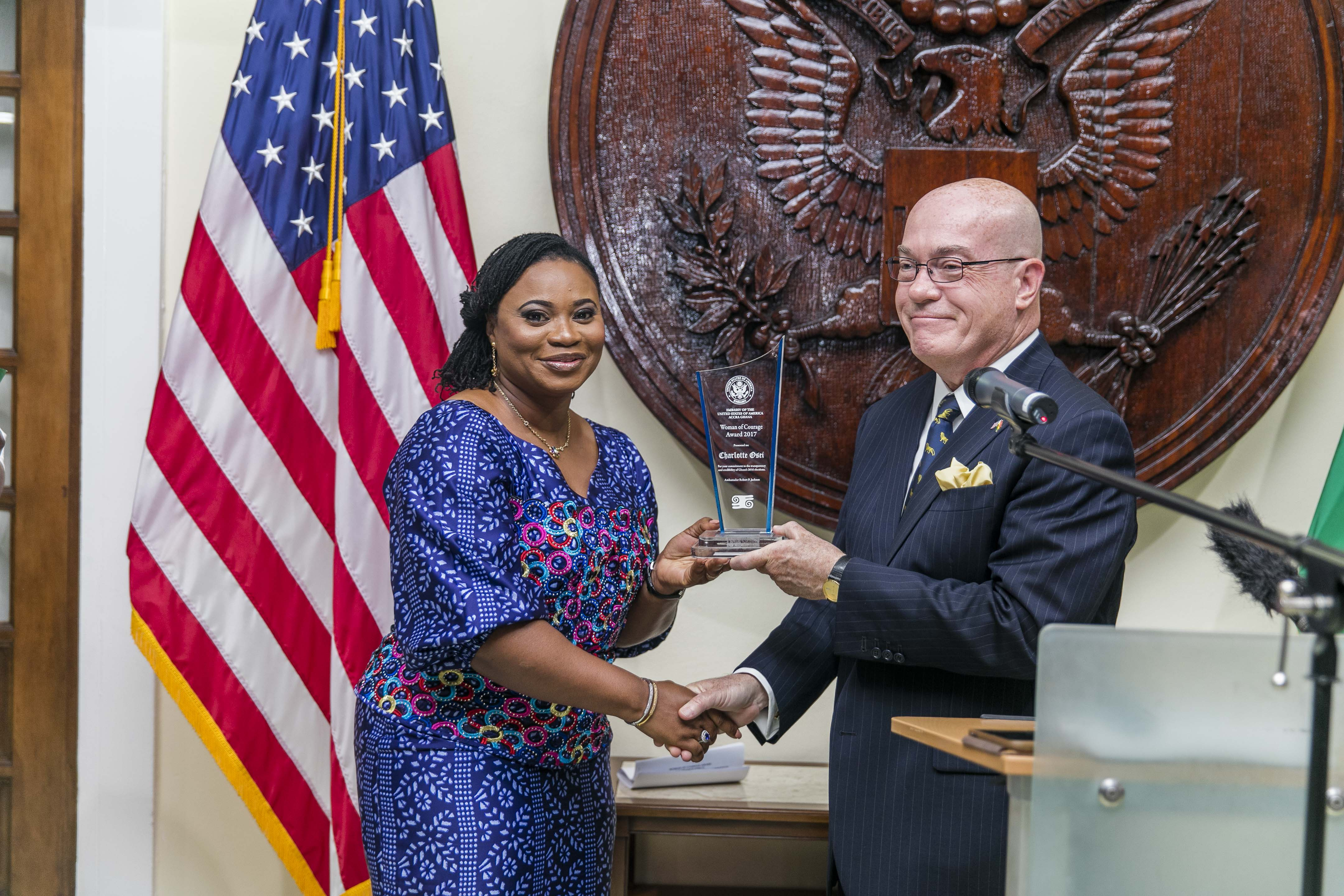 Ambassador Robert P. Jackson presenting the the Woman of Courage Award to Electoral Commission Chair Charlotte Osei
