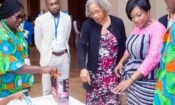 The Minister of Gender and USAID Ghana Mission Director interact with exhibitors